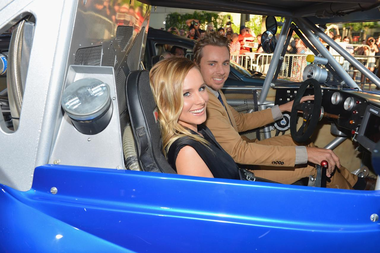 """LOS ANGELES, CA - AUGUST 14:  Actors Dax Shepard and Kristen Bell (L) arrive to the premiere of Open Road Films' """"Hit and Run"""" on August 14, 2012 in Los Angeles, California.  (Photo by Alberto E. Rodriguez/Getty Images)"""