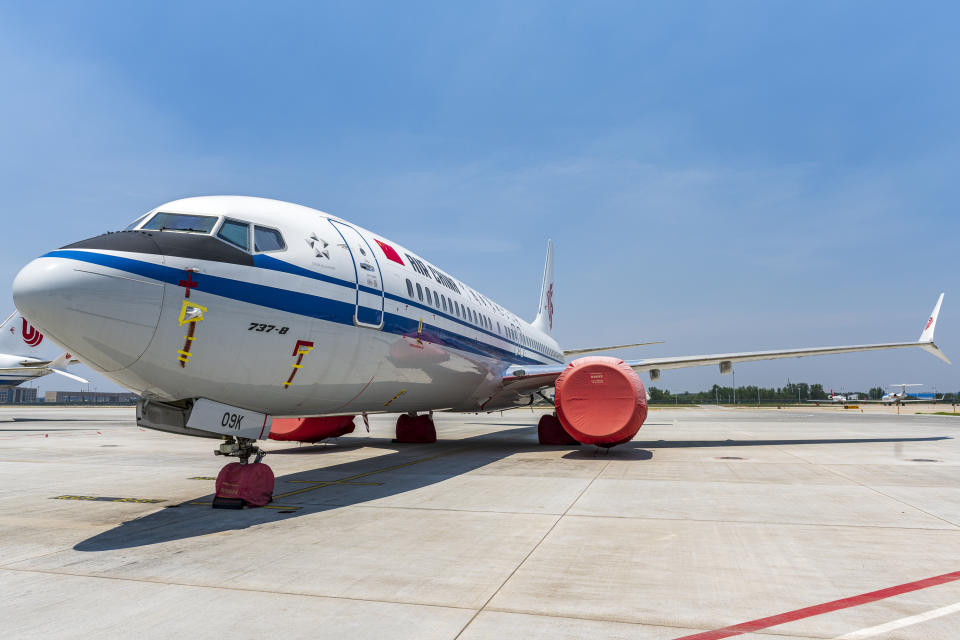 A Boeing 737 Max jet plane of Air China is parked at the Beijing Capital International Airport in Beijing, China, 4 July 2019. Boeing said it will provide $100 million over several years to help families and communities affected by two crashes of its 737 Max plane that killed 346 people. (Photo by Chen chen - Imaginechina/Sipa USA)