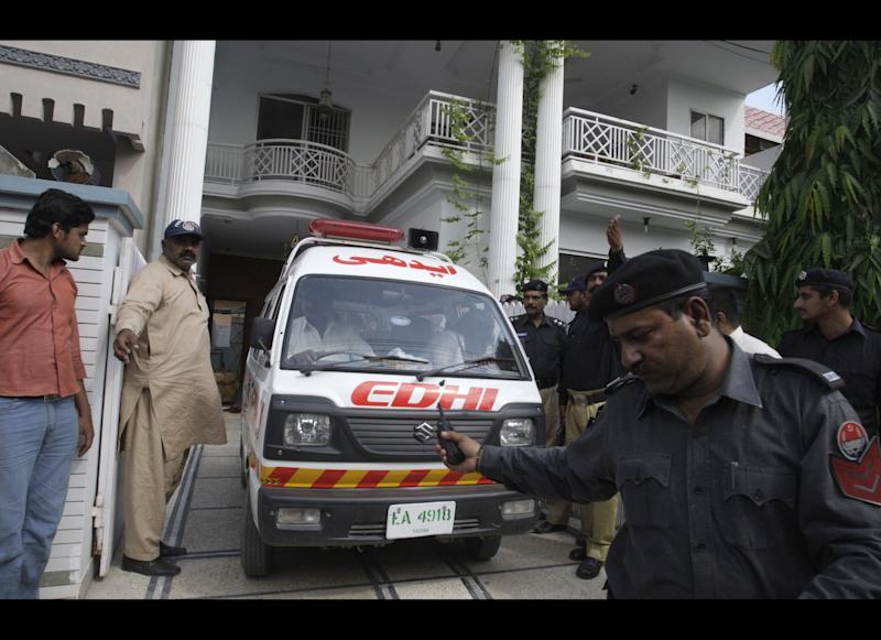 "An ambulance removes dead bodies of shooting victims from a house in Lahore, Pakistan on Monday, April 30, 2012. The widow and mother-in-law of one of two Pakistanis men shot and killed by a CIA contractor last year, have been murdered in Lahore, police said. It appears the killings may have been related to the large amount of ""blood money"" Zohra Haider received to pardon her husband's killer, Raymond Davis. (AP Photo/K.M. Chaudary)"