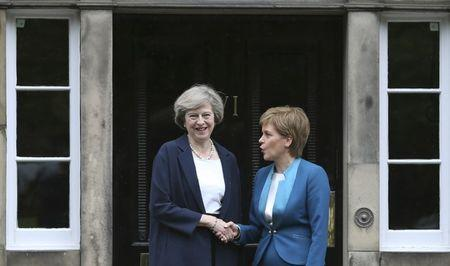 FILE PHOTO - Scotland's First Minister Nicola Sturgeon greets Britain's new Prime Minister Theresa May as she arrives at Bute House in Edinburgh