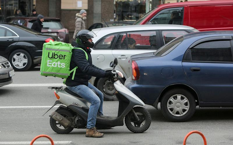 UBER based service of food delivery employee on a motor scooter in Kyiv, Ukraine, February 5,2019 (Photo by Sergii Kharchenko/NurPhoto via Getty Images)