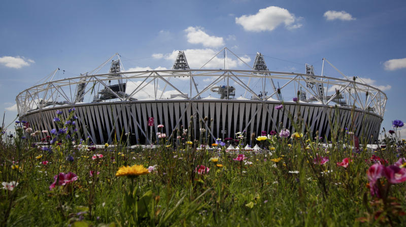 The Olympic Stadium is visible beyound an installation of artificial wildflowers in the Olympic Park at the 2012 London Summer Olympics, Sunday, July 22, 2012, in London. The opening ceremonies of the Olympic Games are scheduled for Friday, July 27. (AP Photo/Ben Curtis)