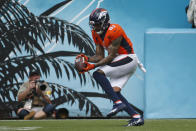 Denver Broncos wide receiver Tim Patrick makes a reception on his way to a touchdown on a 12-yard play against the Jacksonville Jaguars during the first half of an NFL football game, Sunday, Sept. 19, 2021, in Jacksonville, Fla. (AP Photo/Stephen B. Morton)
