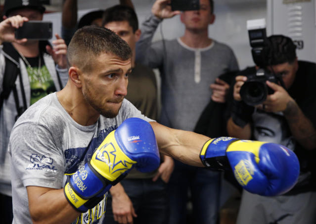 FILE - In this Dec. 6, 2017 file photo, WBO super featherweight champion Vasyl Lomachenko, of Ukraine, punches a bag during a workout at a Manhattan boxing gym in New York. Lomachenko will fight Jorge Linares, Saturday, May 12, 2018, for Linares' WBA lightweight championship in New York. (AP Photo/Kathy Willens, File )