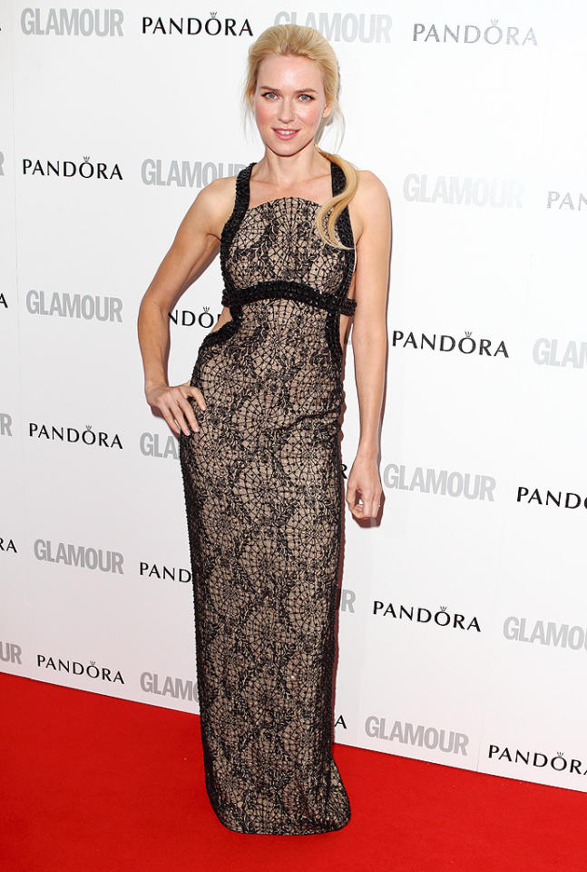 "Naomi Watts, 43, showed a sexier side in a black lace Versace gown, which featured a low-cut back and was covered in black Swarovski crystals. The actress will soon be playing Princess Diana in the film ""Caught in Flight."" ""I'm looking forward to it, but am absolutely terrified,"" she recently said about the role. ""It's going to be a tough one. It's a big beast to take on. I just try to do my best."""