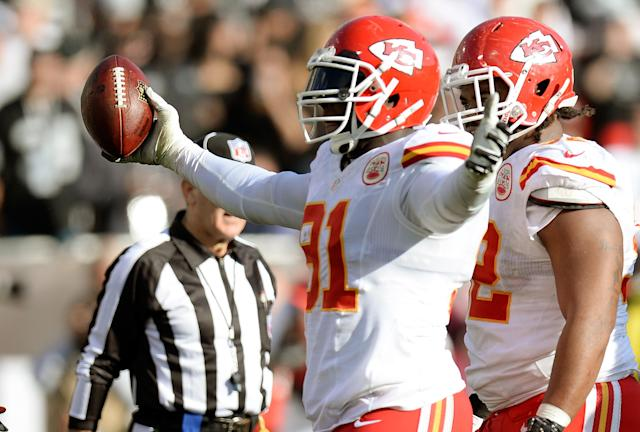 OAKLAND, CA - DECEMBER 15: Tamba Hali #91 of the Kansas City Chiefs celebrates after recovering a fumble against the Oakland Raiders during the second quarter at O.co Coliseum on December 15, 2013 in Oakland, California. (Photo by Thearon W. Henderson/Getty Images)
