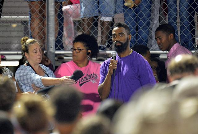 Olympic sprinter Tyson Gay speaks during a candlelight vigil at Lafayette High School for his daughter Trinity Gay, who died in an exchange of gunfire early Sunday morning, in Lexington, Kentucky, October 17, 2016. REUTERS/Bryan Woolston