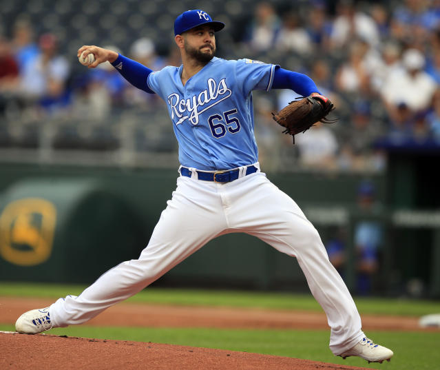 Kansas City Royals starting pitcher Jakob Junis delivers to a Toronto Blue Jays batter during the first inning of a baseball game at Kauffman Stadium in Kansas City, Mo., Wednesday, July 31, 2019. (AP Photo/Orlin Wagner)