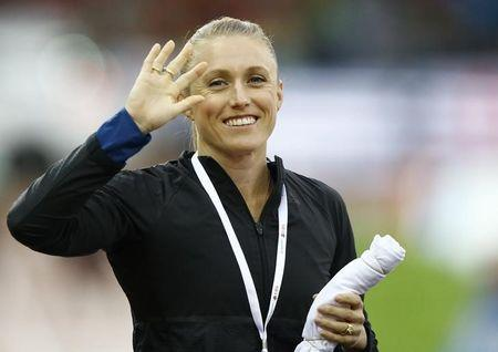 Sally Pearson of Australia gestures. REUTERS/Denis Balibouse