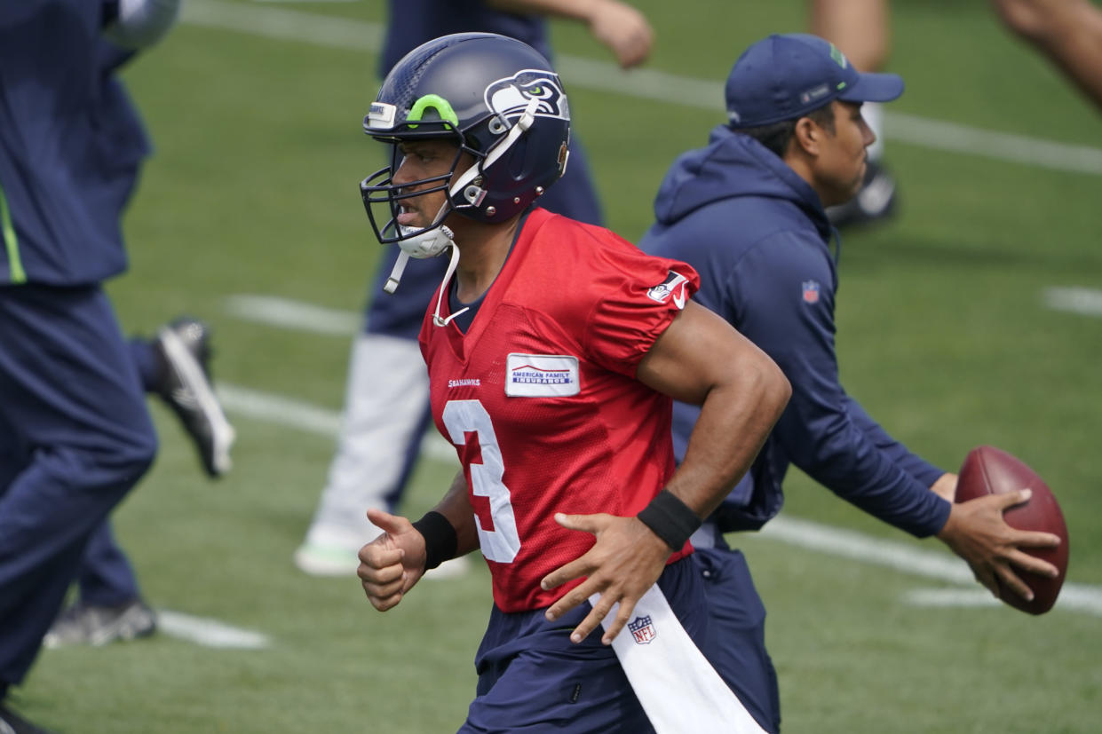 Seattle Seahawks quarterback Russell Wilson runs during NFL football practice Tuesday, June 8, 2021, in Renton, Wash. (AP Photo/Ted S. Warren)