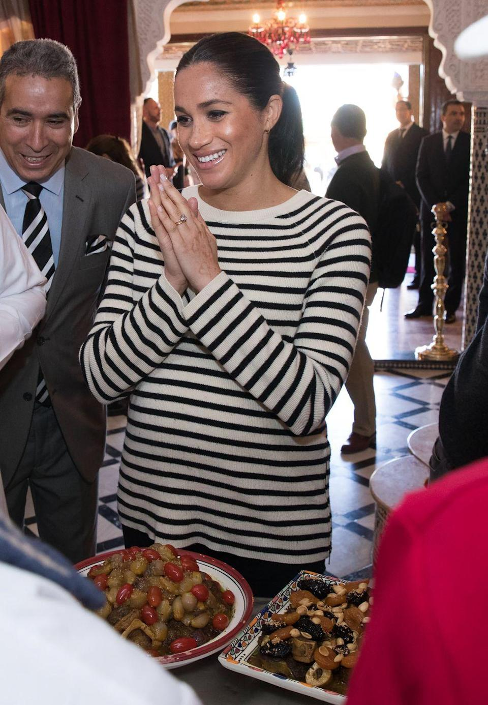 <p>And Meghan wore this classic striped top to a cooking demonstration during her and Prince Harry's royal tour of Morocco in 2019. </p>