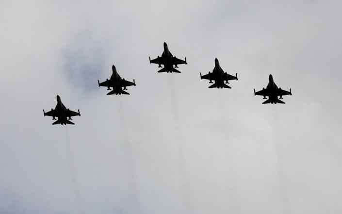 Taiwanese F-16 fighter jets fly in formation - Ann Wang/Reuters