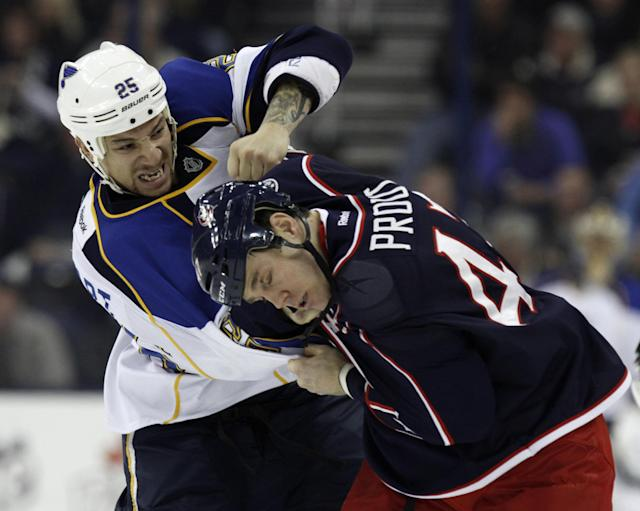 St. Louis Blues' Chris Stewart, left, fights with Columbus Blue Jackets' Dalton Prout in the first period of an NHL hockey game in Columbus, Ohio, Saturday, Dec. 14, 2013. (AP Photo/Paul Vernon)