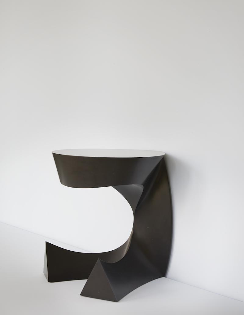 Bakker's Sitting Table is made out of Noir Belge de Mazy marble.