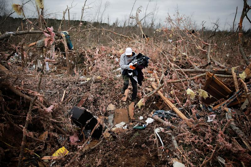 Dax Leandro salvages clothing from the wreckage of his friend's home after two back-to-back tornadoes touched down, in Beauregard, Alabama, March 4, 2019. (Photo: Elijah Nouvelage/Reuters)