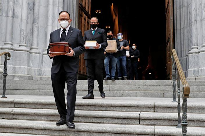 Mexican Consul General Jorge Islas Lopez leads people carrying cremated remains after a prayer service at Saint Patrick's Cathedral in New York on July 11. The service was held to bless the ashes of Mexicans who died during the coronavirus pandemic but could not have funeral Masses or burials.