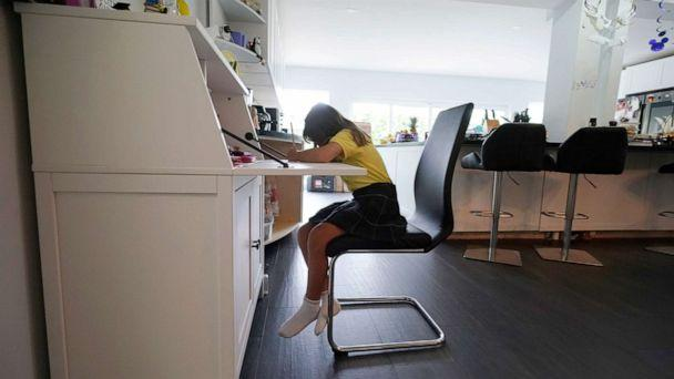 PHOTO: A student works on a writing exercise from remote learning at her home in North Miami Beach, Fla. Oct. 1, 2020. (Wilfredo Lee/AP, FILE)