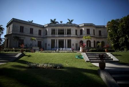 A view from the gardens shows the terrace of the U.S. ambassadorial residence, where U.S. President Barack Obama, his wife and first lady Michelle Obama, their two daughters Malia and Sasha and the first lady's mother Marian Robinson are scheduled to stay during the first visit by a U.S. president to Cuba in 88 years, in Havana, March 14, 2016. REUTERS/Alexandre Meneghini