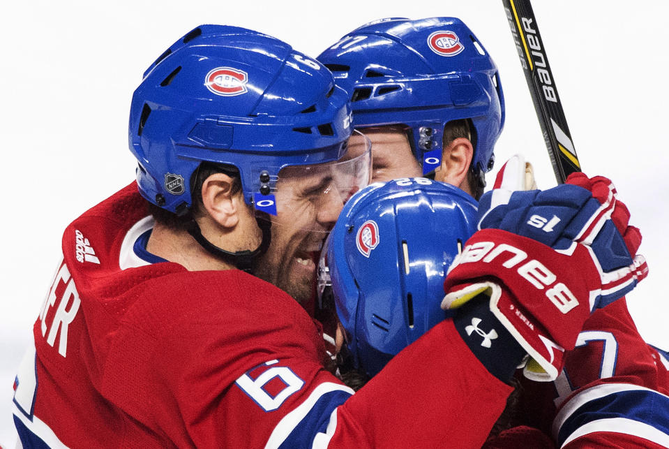 Montreal Canadiens' Shea Weber, left, celebrates with teammates Jonathan Drouin (92) and Brett Kulak after scoring against the New York Rangers during the first period of an NHL hockey game, Saturday, Dec. 1, 2018, in Montreal. (Graham Hughes/The Canadian Press via AP)
