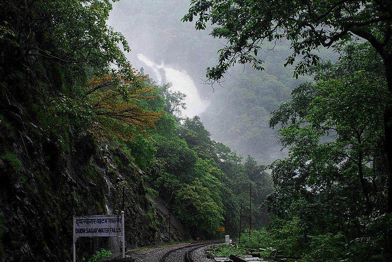 """The first view of Dudhsagar Waterfalls.<br><br><b>Love train rides? You may also enjoy:</b><br> <a target=""""_blank"""" href=""""https://in.lifestyle.yahoo.com/photos/riding-the-historic-nilgiri-mountain-railway-slideshow/"""">Riding the historic Nilgiri Mountain Railway</a>"""