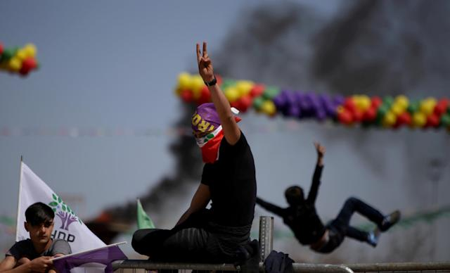 People gesture during a gathering celebrating Newroz, which marks the arrival of spring and the new year, in Diyarbakir, Turkey March 21, 2018. REUTERS/Sertac Kayar TPX IMAGES OF THE DAY