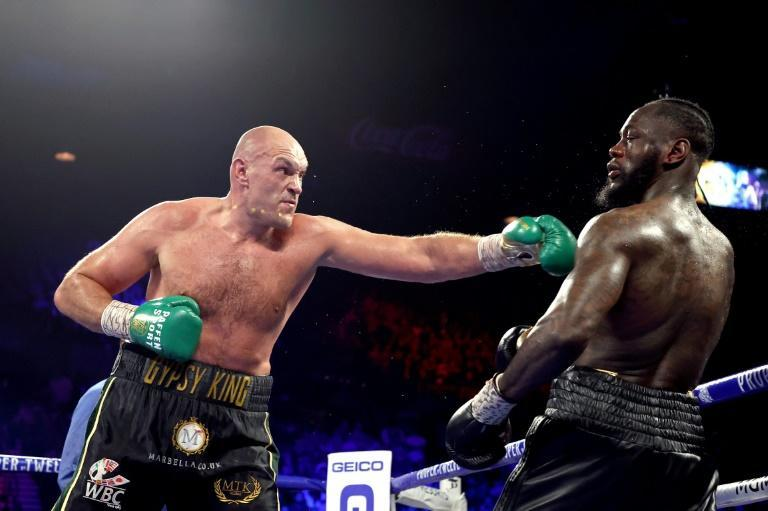 Tyson Fury (left) in action against Deontay Wilder during their heavyweight bout in Las Vegas (AFP Photo/AL BELLO)