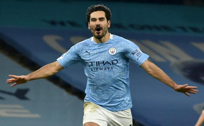 Manchester City midfielder Ilkay Gundogan celebrates scoring against Tottenham