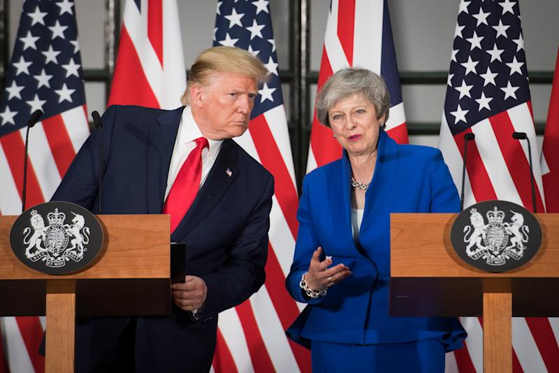 US President Donald Trump (L) and Britain's Prime Minister Theresa May attend a joint press conference at the Foreign and Commonwealth office in London on June 4, 2019, on the second day of their three-day State Visit to the UK. - US President Donald Trump turns from pomp and ceremony to politics and business on Tuesday as he meets Prime Minister Theresa May on the second day of a state visit expected to be accompanied by mass protests. (Photo by Stefan Rousseau / POOL / AFP) (Photo credit should read STEFAN ROUSSEAU/AFP/Getty Images)