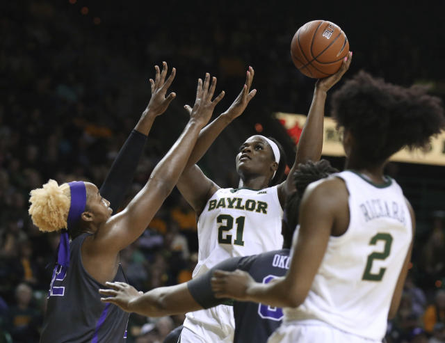 Baylor center Kalani Brown, right, scores over TCU center Jordan Moore, left, in the second half of an NCAA college basketball game, Saturday, Feb. 9, 2019, in Waco, Texas. Baylor won 89-71. (AP Photo/Rod Aydelotte)