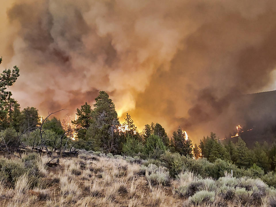 This photo provided by the Oregon Department of Forestry shows active fire along a ridge at the Grandview Fire near Sisters, Ore., Sunday, July 11, 2021. The wildfire doubled in size to 6.2 square miles (16 square kilometers) Monday, forcing evacuations in the area, while the state's biggest fire continued to burn out of control, with containment not expected until November. (Oregon Department of Forestry via AP)