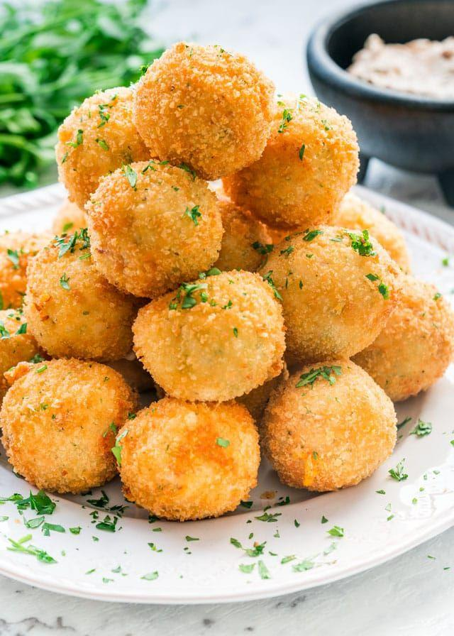 """<p>Mashed potatoes meet two kinds of cheese and a smattering of bacon in this easy-to-eat holiday appetizer. We'll take forty.</p><p><strong>Get the recipe at <a href=""""https://www.jocooks.com/recipes/potato-croquettes/"""" target=""""_blank"""">Jo Cooks</a>.</strong></p><p><strong><strong><a class=""""body-btn-link"""" href=""""https://www.amazon.com/KUKPO-Stainless-Potato-Ergonomic-Horizontal/dp/B014EMKW9S?tag=syn-yahoo-20&ascsubtag=%5Bartid%7C10050.g.2696%5Bsrc%7Cyahoo-us"""" target=""""_blank"""">SHOP POTATO MASHERS</a></strong><br></strong></p>"""