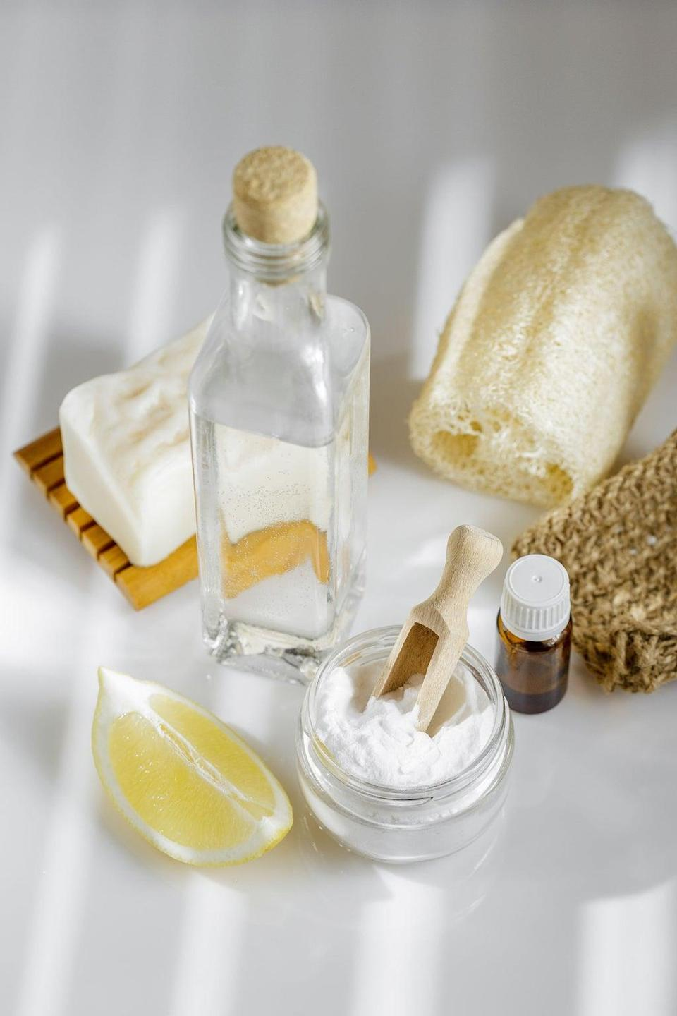A Generic Photo of white vinegar, baking soda, lemon, aroma oil, plus solid natural soap and a luffa sponge, ready for cleaning. See PA Feature. Picture credit should read: Alamy/PA. WARNING: This picture must only be used to accompany PA Feature HOMES Scent.