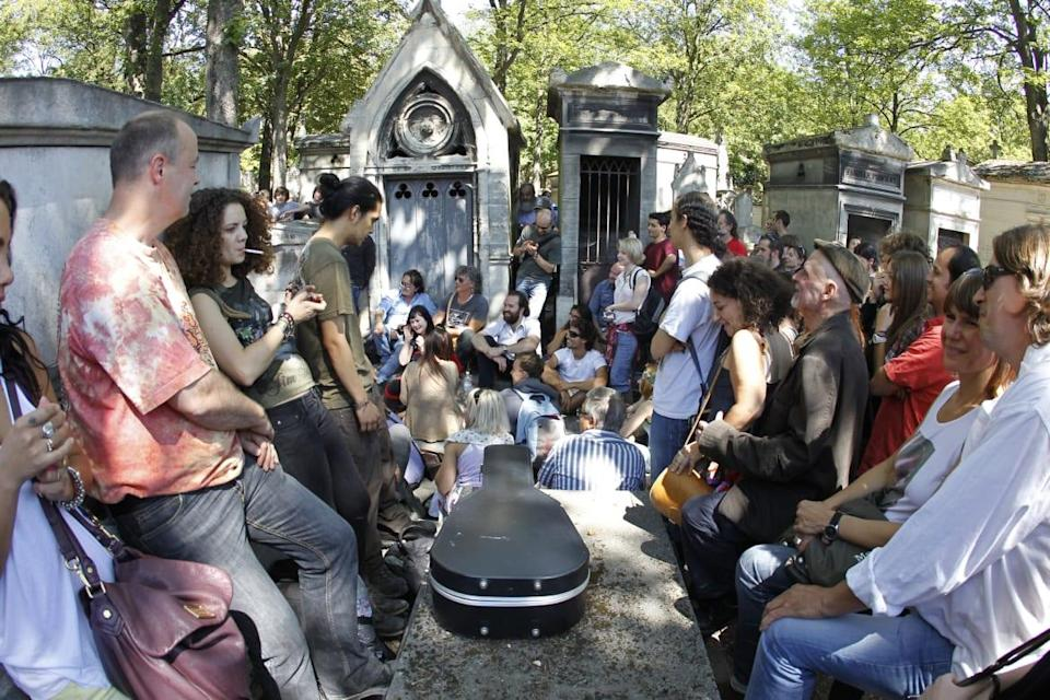 """<div class=""""inline-image__caption""""><p>A group of people gather to pay homage, on July 3, 2011, in front of singer Jim Morrison's tomb at the Pere Lachaise cemetery in Paris, 40 years after Morrison was found dead in a bathtub in his Paris apartment.</p></div> <div class=""""inline-image__credit"""">Francois Guillot/AFP/Getty</div>"""