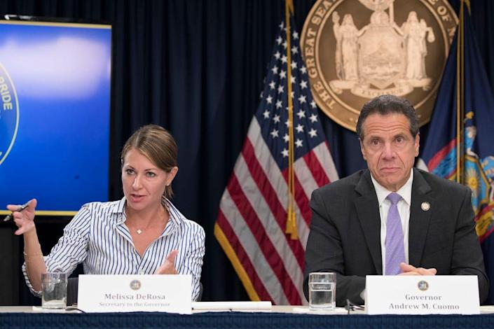 """In this Sept. 14, 2018 file photo, Secretary to the Governor Melissa DeRosa, is joined by New York Gov. Andrew Cuomo as she speaks to reporters during a news conference, in New York. De Rosa, Cuomo's top aide, told top Democrats frustrated with the administration's long-delayed release of data about nursing home deaths that the administration """"froze"""" over worries about what information was """"going to be used against us,"""" according to a Democratic lawmaker who attended the Wednesday, Feb. 10, 2021 meeting and a partial transcript provided by the governor's office. (AP Photo/Mary Altaffer, File)"""