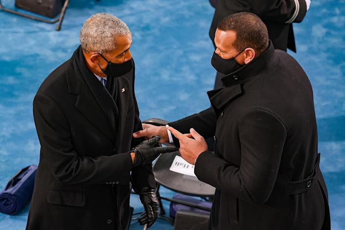 <p>Obama and Alex Rodriguez, whose fiancée Jennifer Lopez performed at the inauguration, friendly points in a quick hello. </p>