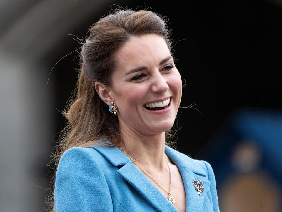 Britain's Catherine, Duchess of Cambridge reacts during a Beating of the Retreat at Holyroodhouse Palace in Edinburgh, Scotland (REUTERS)
