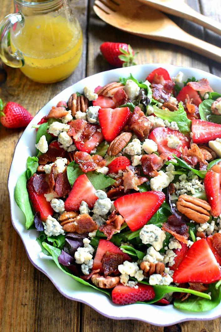 """<p>A picnic calls for a salad that's refreshing and easy to make and take - and this one definitely fits the bill!</p><p><u><em>Get the recipe at <a href=""""http://www.lemontreedwelling.com/2016/04/strawberry-bacon-blue-cheese-salad.html"""" rel=""""nofollow noopener"""" target=""""_blank"""" data-ylk=""""slk:Lemon Tree Dwelling"""" class=""""link rapid-noclick-resp"""">Lemon Tree Dwelling</a>. </em></u></p>"""