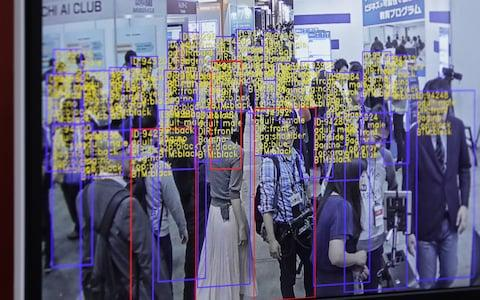 The object detection and tracking technology developed by SenseTime Group Ltd. is displayed on a screen at the Artificial Intelligence Exhibition & Conference in Tokyo, Japan, on Wednesday, April 4, 2018 - Credit: Bloomberg