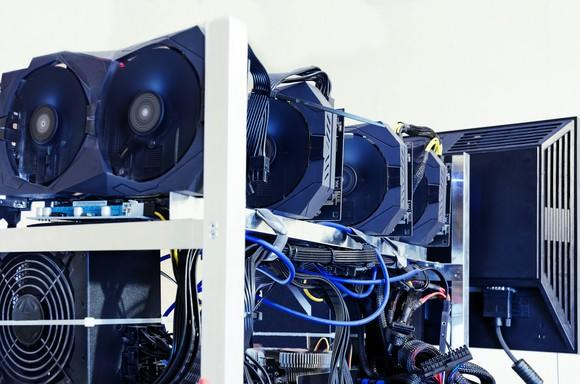 Multiple hard drives and graphics cards being used to mine digital currencies.