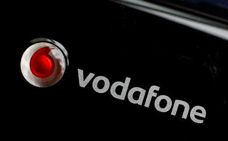 FILE PHOTO:  A Vodafone logo is seen on a mobile internet dongle in this photo illustration