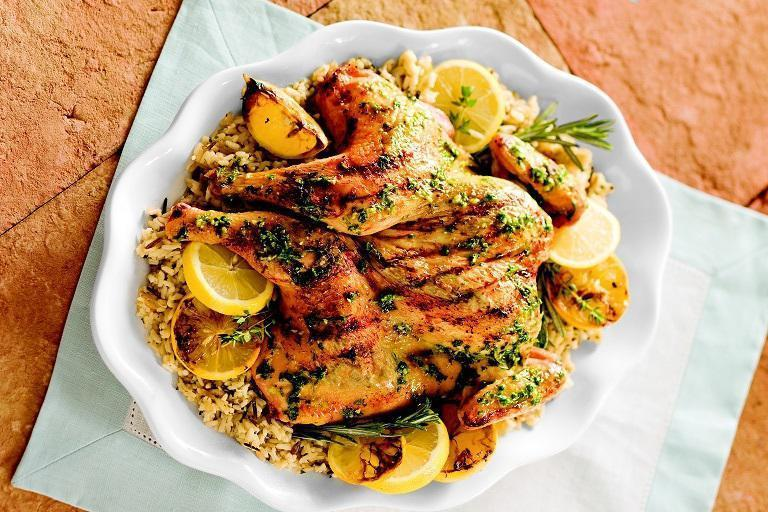 """<p>With rosemary, thyme, basil, cilantro and chives, this grilled chicken is both earthy and delicious. The fresh herbs make all the difference, as does the squeeze of fresh lemon juice and a whole head of garlic. </p> <p><a href=""""https://www.thedailymeal.com/best-recipes/butterflied-herb-lemon-grilled-chicken?referrer=yahoo&category=beauty_food&include_utm=1&utm_medium=referral&utm_source=yahoo&utm_campaign=feed"""" rel=""""nofollow noopener"""" target=""""_blank"""" data-ylk=""""slk:For the Butterflied Herb and Lemon Grilled Chicken recipe, click here."""" class=""""link rapid-noclick-resp"""">For the Butterflied Herb and Lemon Grilled Chicken recipe, click here.</a></p>"""
