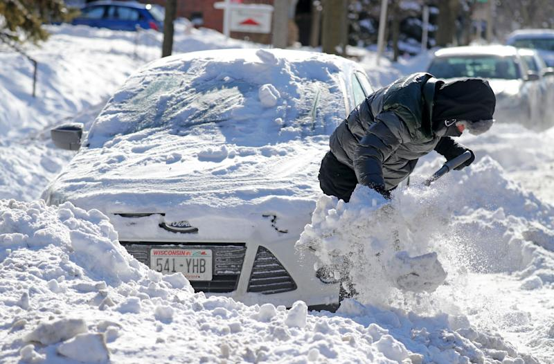 Israel Montelongo, a University Of Wisconsin Milwaukee student, from Delevan, WI. Works to shovel out his car on North Oakland Avenue just north of East Hartford Avenue in Milwaukee on Wednesday, Jan. 30, 2019. The National Weather Service in Sullivan issued it's first wind chill warning in five years, as schools, businesses and governments announced closures. A polar vortex is funneling extremely cold air from the North Pole right into Wisconsin. Milwaukee and southeastern Wisconsin were being hit head-on by the polar vortex Wednesday morning. The temperature was minus 18 degrees and the wind chill was minus 46 in Milwaukee. Wind chills hit minus 51 in Sheboygan, minus 50 in Waukesha and minus 47 at Timmerman Field in Milwaukee early Wednesday, according to the National Weather Service.