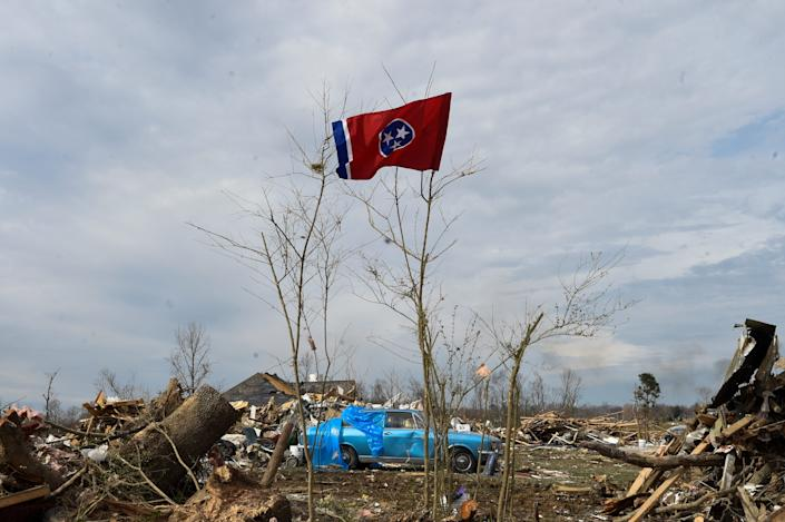 The state flag flies amid rubble on Charlton Square in Baxter, Tenn., on Wednesday, March 5, 2020.