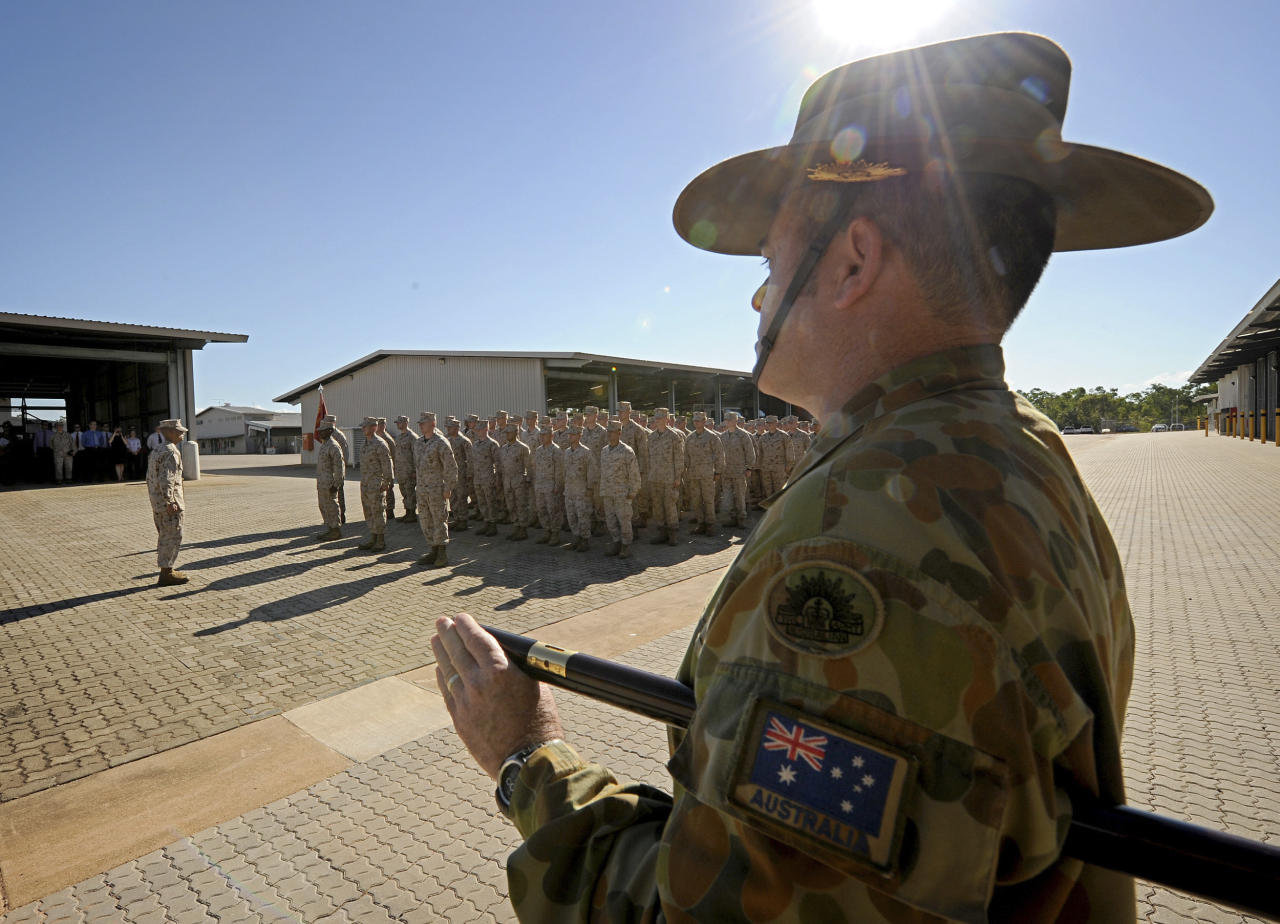 In this photo released by Australian Department of Defence, Regimental Sergeant Major Dale DeKock of 5th Battalion (Mechanised) Royal Australian Regiment is on parade before the United States Marine Corps personnel during the Australian Minister for Defence's official welcome ceremony at Robertson Barracks in Darwin, Australia, Wednesday, April 4, 2012. Approximately 200 Marines of Fox Company, 2nd Battalion, 3rd Marine Regiment, arrived at RAAF Base Darwin to begin the lead up to moving out field and commencing exercises in some of the Australian Defence Force's premier training areas in Northern Australia. (AP Photo/CPL Chris Dickson) NO SALES, EDITORIAL USE ONLY