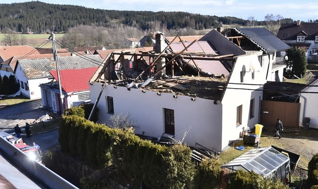 The roof of a house is damaged in Rohozna, Czech Republic (Lubos Pavlicek/CTK/AP)