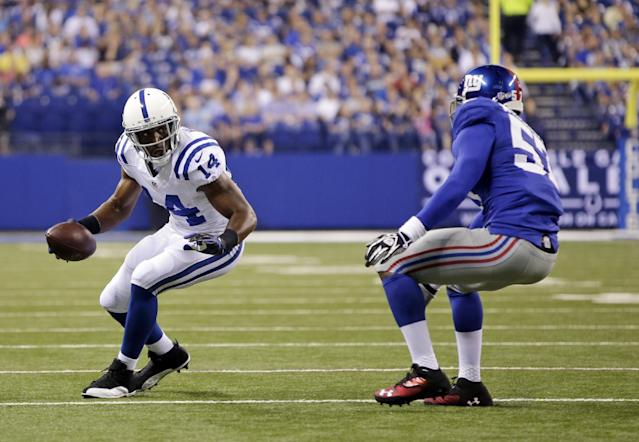 Indianapolis Colts' Hakeem Nicks (14) is defended by New York Giants' Jacquian Williams (57) during the first half of an NFL preseason football game Saturday, Aug. 16, 2014, in Indianapolis. (AP Photo/AJ Mast)