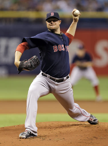 Boston Red Sox starting pitcher Jon Lester delivers to the Tampa Bay Rays during the first inning of a baseball game on Friday, July 25, 2014, in St. Petersburg, Fla. (AP Photo/Chris O'Meara)