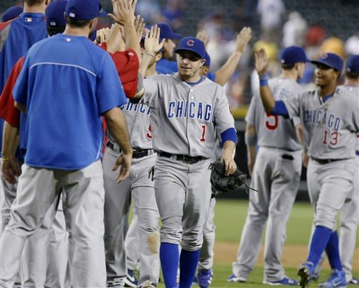 Chicago Cubs center fielder Tony Campana (1) and teammates celebrate after defeating the Arizona Diamondbacks 7-2 in a baseball game Sunday, Sept. 30, 2012, in Phoenix. (AP Photo/Rick Scuteri)