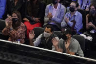 Tennis great Roger Federer, center, waves to the crowd while sitting courtside during Laver Cup tennis, Saturday, Sept. 25, 2021, in Boston. (AP Photo/Elise Amendola)