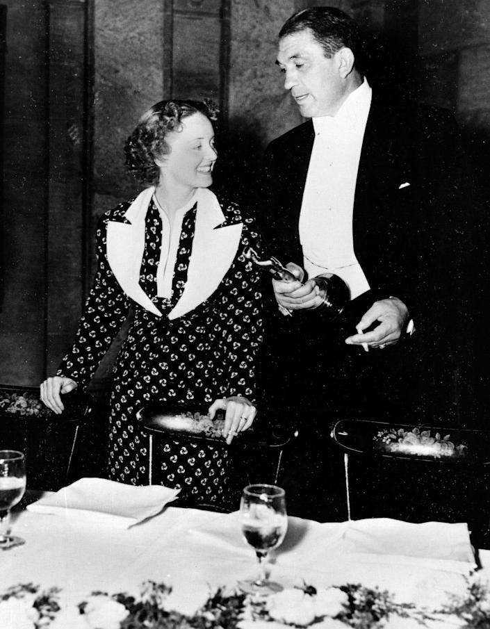 Bette Davis and Victor McLaglen are shown after winning their Oscars at the 1935 Academy Awards banquet held at the Biltmore Bowl, Biltmore Hotel in Los Angeles, Ca., on March 5, 1936